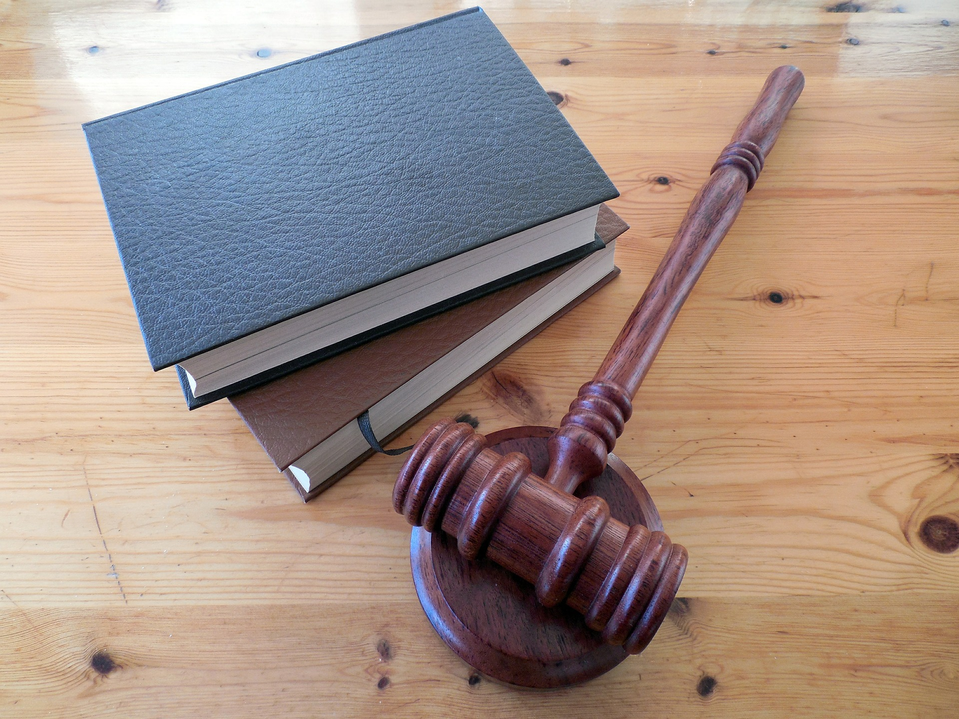 An image showing books and hammer of law