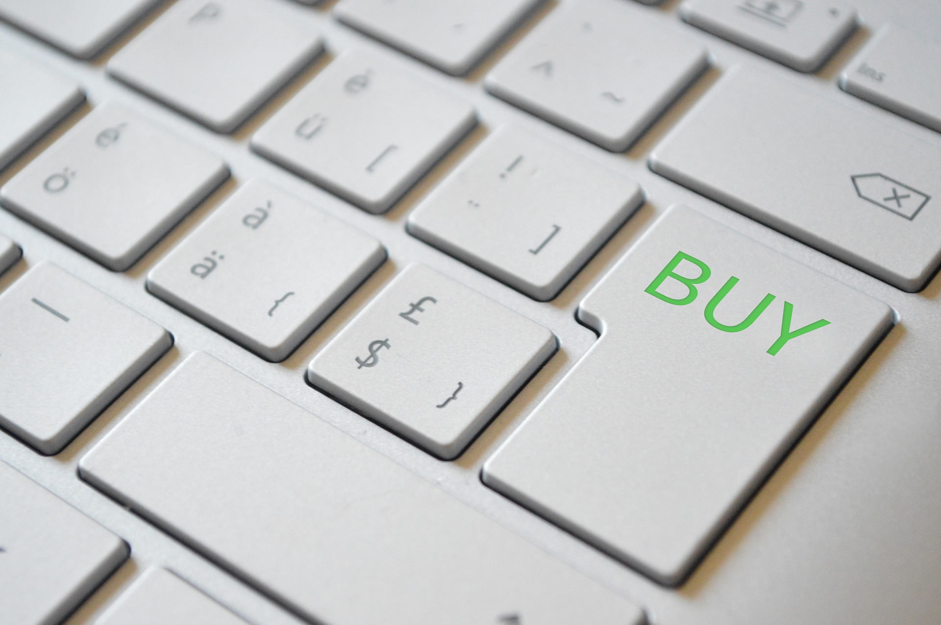 A white keyboard showing the buy button with green color
