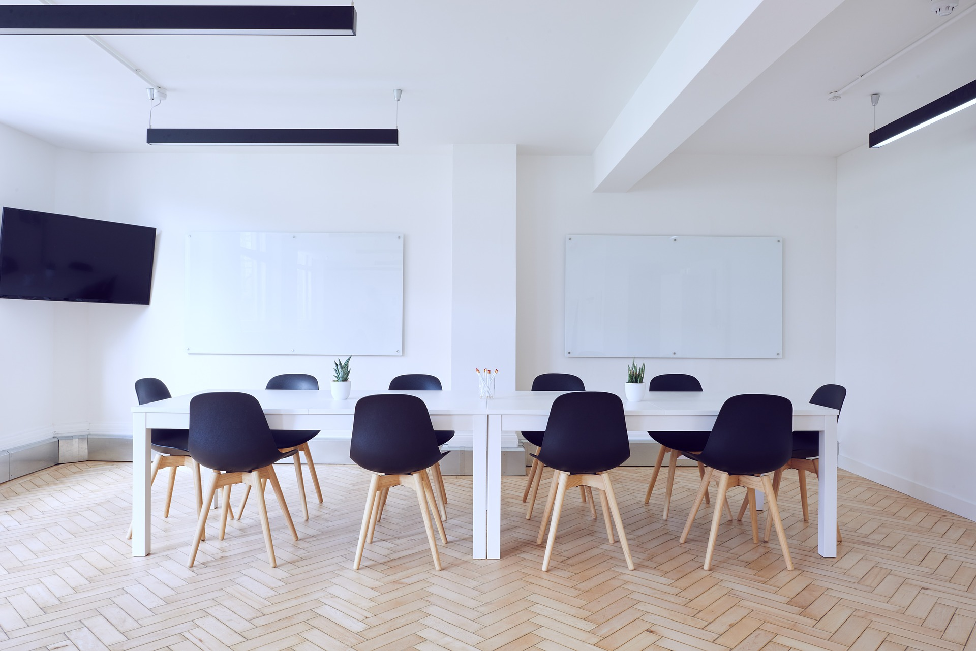 A picture of a meeting room with blue chairs