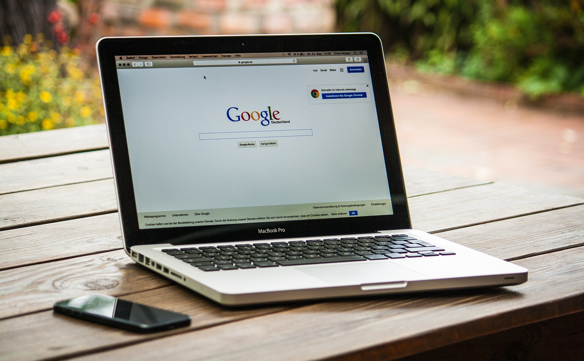 an image of apple mac book with google on it screen