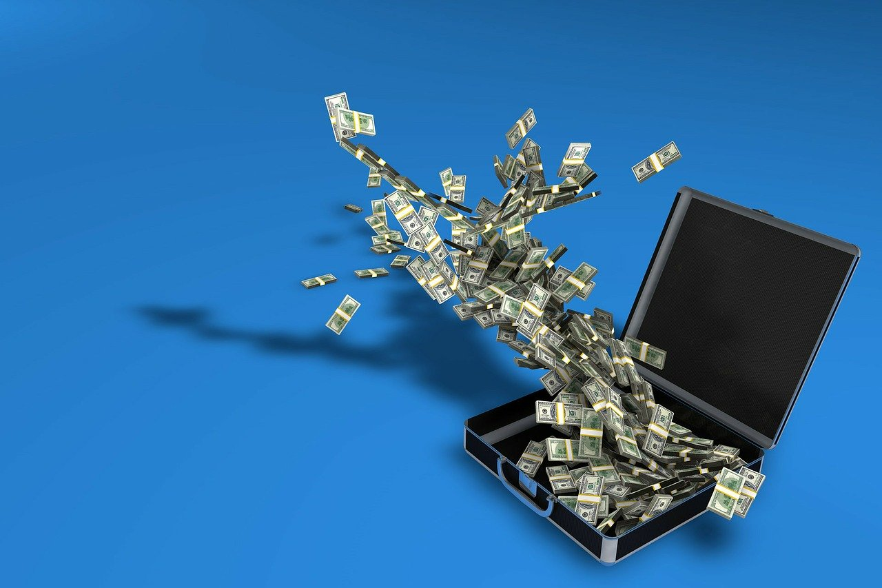 an image of a suitcase full of money with blue background inferring to revenue leakage