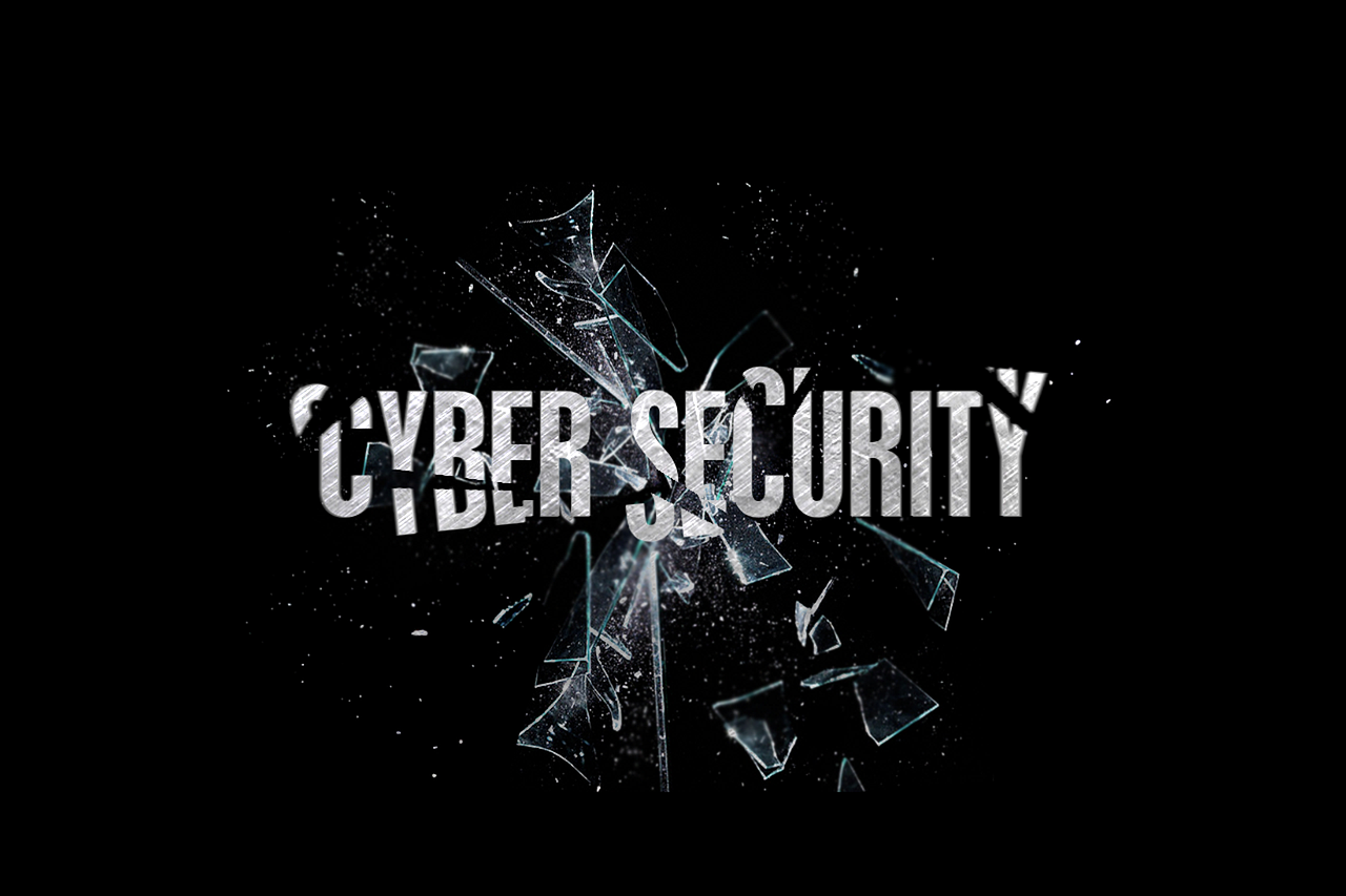 An image with black background with cybersecurity written in white with broken glass