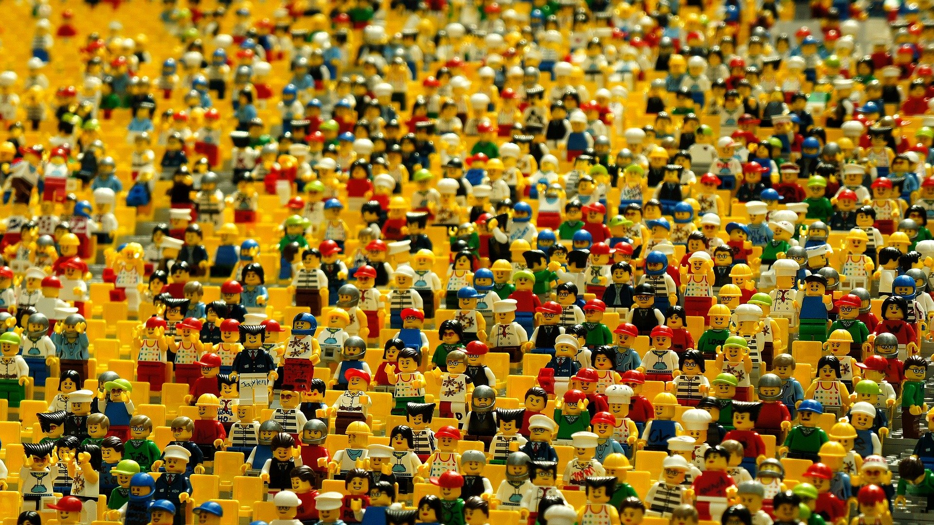 An image that is crowd with the help of yellow lego  humans used to signify market saturation