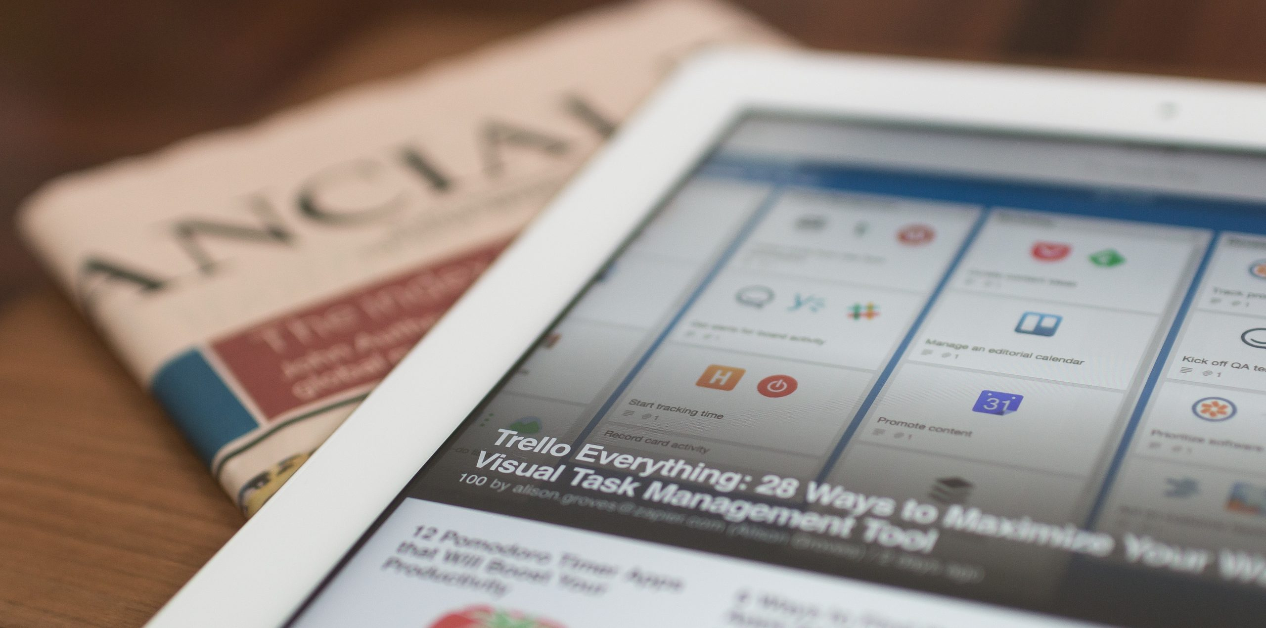 An image of a newspaper and a tab showing the importance of headlines for better click through rate
