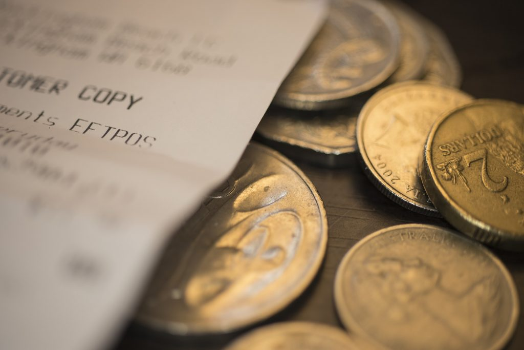 An image of coins and bill to depict the customer spent