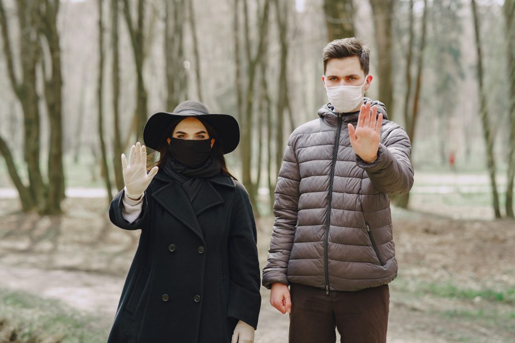 a woman and a man wear mask for their safety in hotel